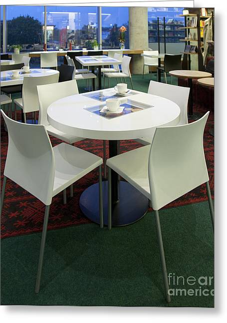 Bookcase Greeting Cards - Dining Room Tables at an Upscale Cafe Greeting Card by Jaak Nilson