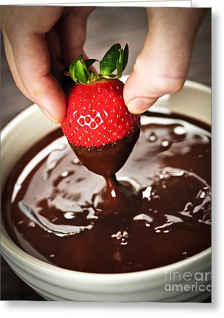 Strawberries Greeting Cards - Dipping strawberry in chocolate Greeting Card by Elena Elisseeva
