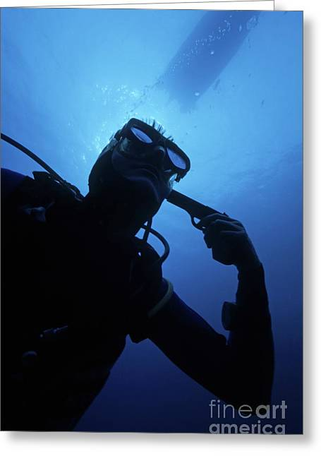 Distraught Greeting Cards - Diver holding gun to head underwater Greeting Card by Sami Sarkis