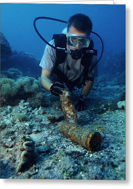 Scuba Diving Greeting Cards - Diver With World War Ii Explosive Shells Greeting Card by Alexis Rosenfeld