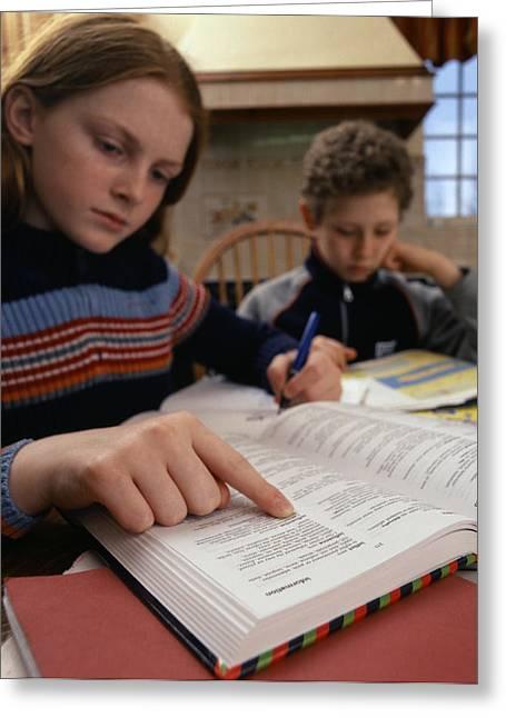 Copying Greeting Cards - Doing Homework Greeting Card by Tek Image