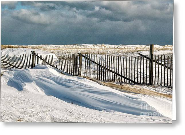 Drifting snow along the beach fences at Nauset Beach in Orleans  Greeting Card by Matt Suess