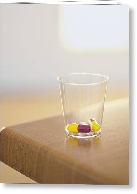 Capsule Greeting Cards - Drug Capsules In A Beaker Greeting Card by Kevin Curtis