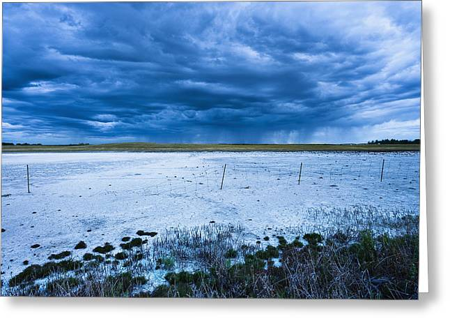 Dry Lake Greeting Cards - Dry Salt Lake And Clouds At Dusk Greeting Card by Yves Marcoux
