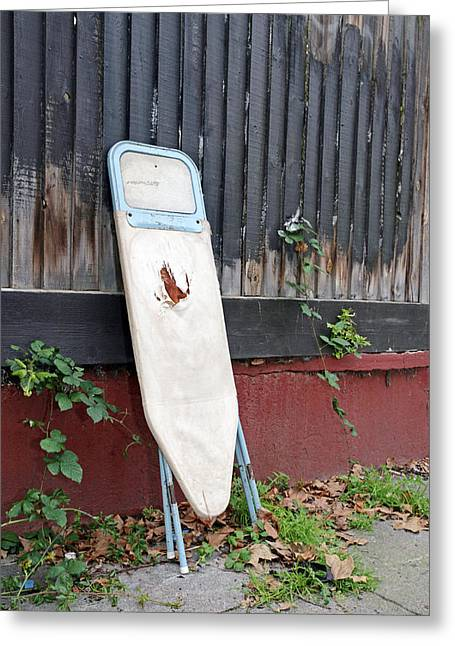 Dumped Ironing Board Greeting Card by Carlos Dominguez