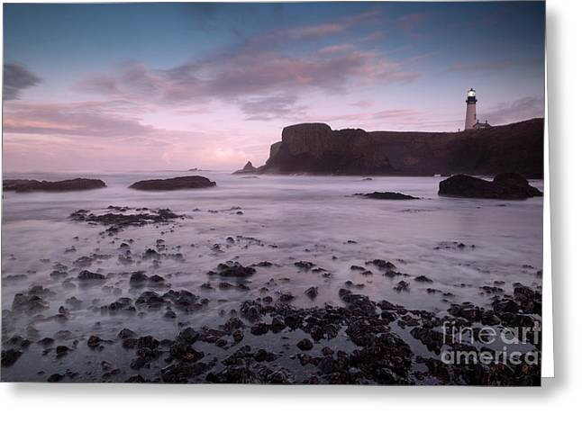 Turbulent Skies Photographs Greeting Cards - Dusk at Yaquina Head Lighthouse Greeting Card by Keith Kapple