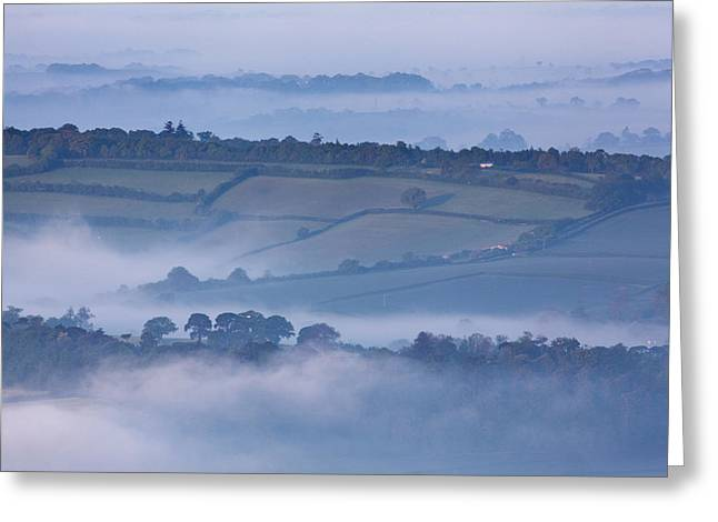 Livelihood Greeting Cards - Early Morning Mist On Hills In South Greeting Card by Nigel Hicks