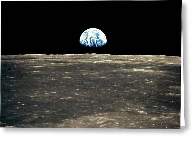 Terra Colors Greeting Cards - Earth Rising Above The Moons Horizon Greeting Card by Stocktrek Images