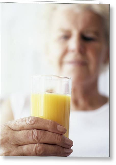 Consume Greeting Cards - Elderly Woman Holding Glass Of Juice Greeting Card by Cristina Pedrazzini