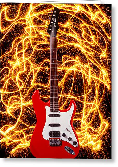 Rock N Roll Photographs Greeting Cards - Electric guitar with sparks Greeting Card by Garry Gay