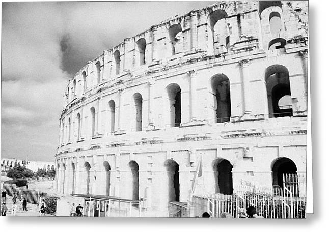 African Heritage Greeting Cards - Entrance and front of the the old roman colloseum against blue cloudy sky el jem tunisia Greeting Card by Joe Fox