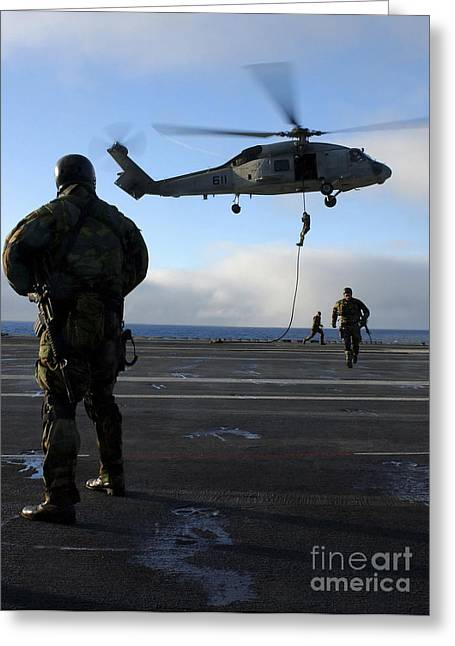 Fast Rope Greeting Cards - Eod Members Simulate Fast Rope Training Greeting Card by Stocktrek Images