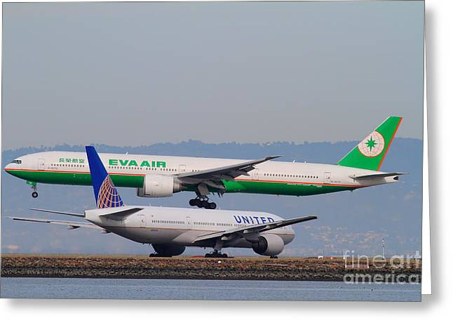 Landing Airplane Greeting Cards - EVA Airways And United Airlines Jet Airplanes At San Francisco International Airport SFO . 7D12256 Greeting Card by Wingsdomain Art and Photography