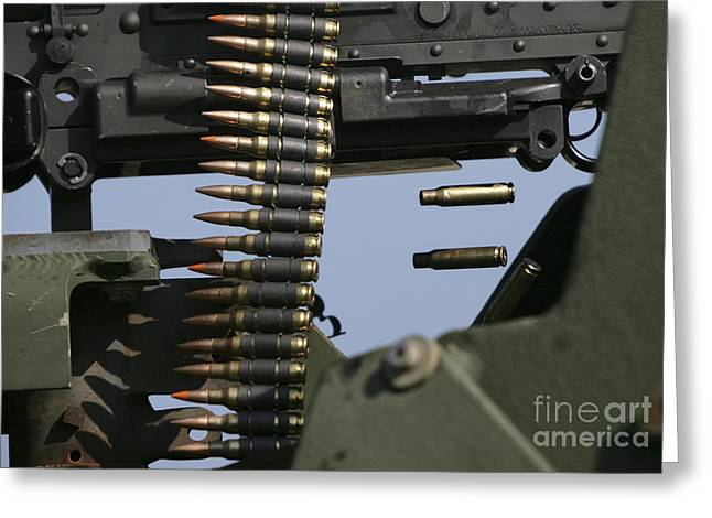 Fed Greeting Cards - Expended Brass Falls From A Machine Gun Greeting Card by Stocktrek Images