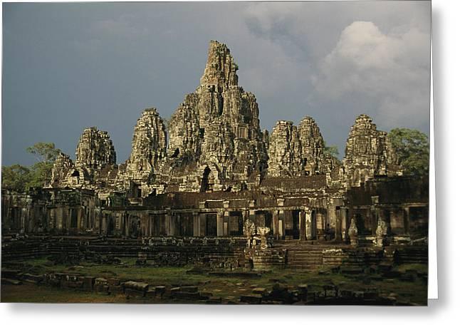 Exterior Of Angkors Bayon Temple Ruins Greeting Card by Richard Nowitz