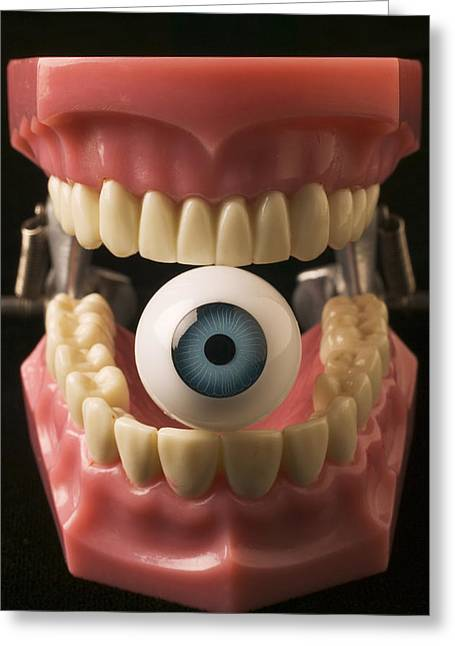Biting Greeting Cards - Eye held by teeth Greeting Card by Garry Gay