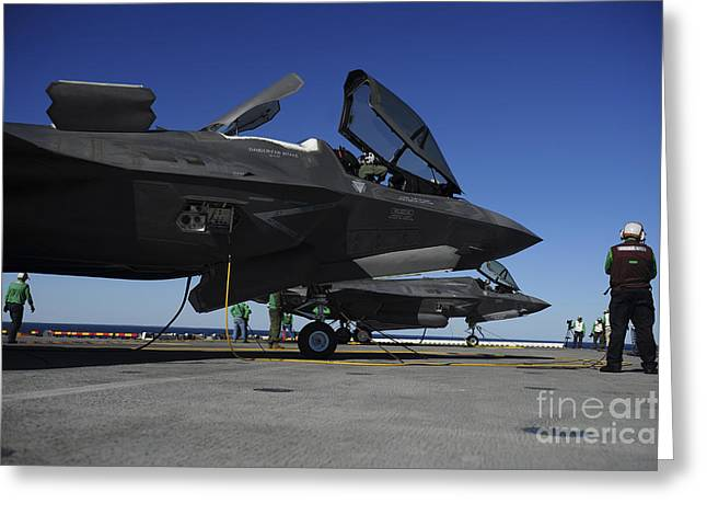 Us Open Photographs Greeting Cards - F-35b Lightning Ii Variants Are Secured Greeting Card by Stocktrek Images