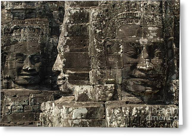 Wat Angkor Greeting Cards - Faces of Banyon Angkor Wat Cambodia Greeting Card by Bob Christopher
