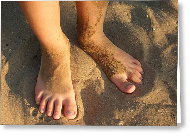 Sand Stand Greeting Cards - Feet of a child in the sand Greeting Card by Matthias Hauser
