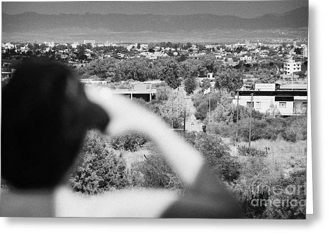 Sight See Greeting Cards - female tourist using binoculars to overlook the UN buffer zone cyprus Greeting Card by Joe Fox