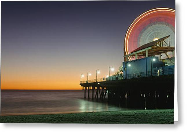 Rollercoaster Photographs Greeting Cards - Ferris Wheel And Rollercoaster At Dusk Greeting Card by Axiom Photographic