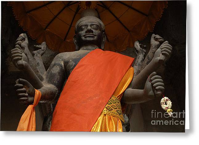 Traveling In Cambodia Greeting Cards - Figure At Angkor Wat Cambodia Greeting Card by Bob Christopher