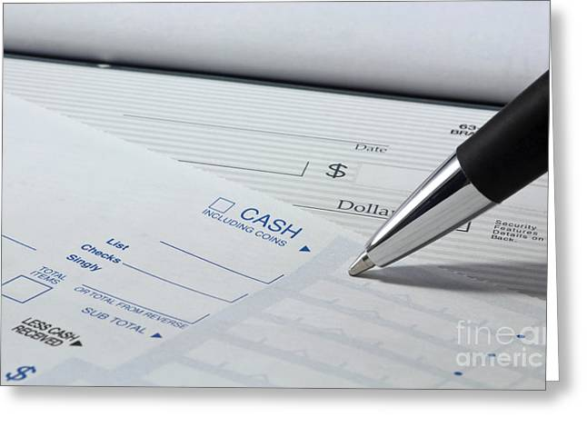 Paper Money Greeting Cards - Filling out deposit slip Greeting Card by Blink Images