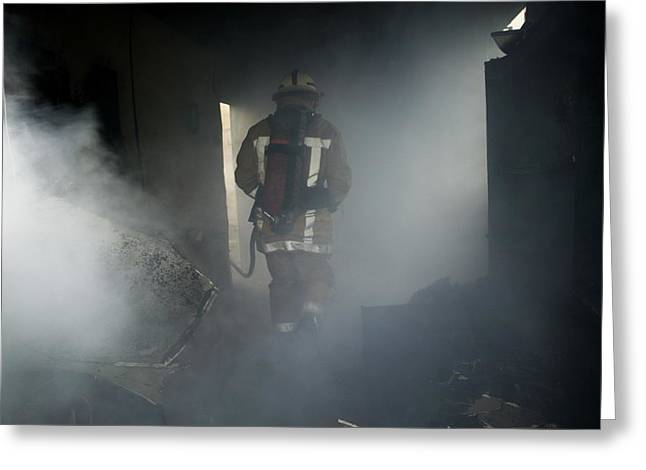 Crime Fighter Greeting Cards - Fire Fighter In A Burnt House Greeting Card by Michael Donne