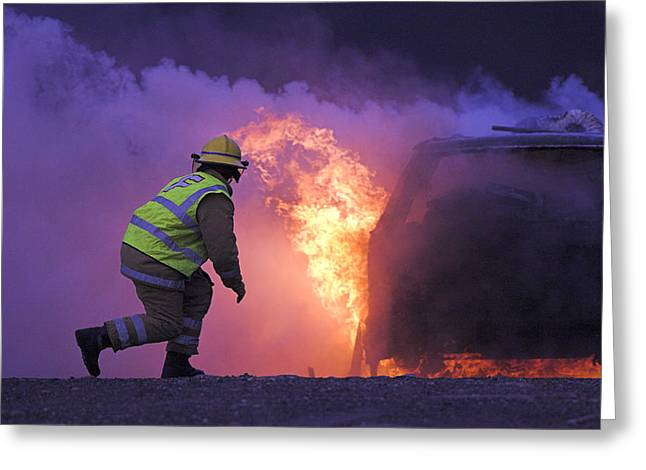 Fed Greeting Cards - Firefighter Tackling A Burning Car Greeting Card by Duncan Shaw