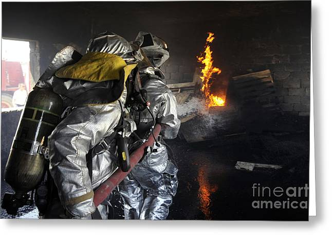 Baghdad Greeting Cards - Firefighters Extinguish A Fire Greeting Card by Stocktrek Images