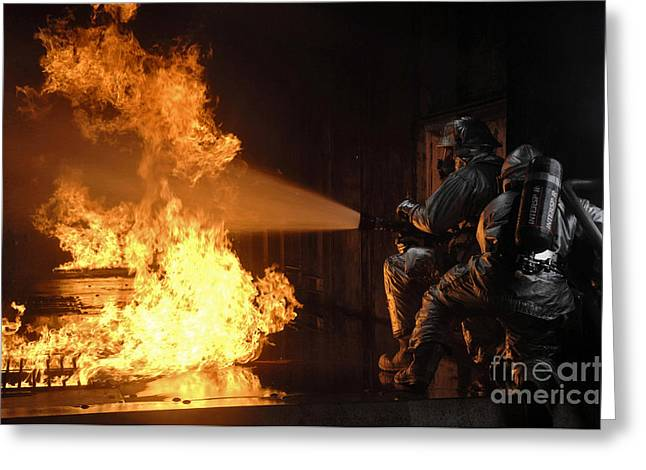 Oxygen Tank Greeting Cards - Firefighters Extinguish A Simulated Greeting Card by Stocktrek Images