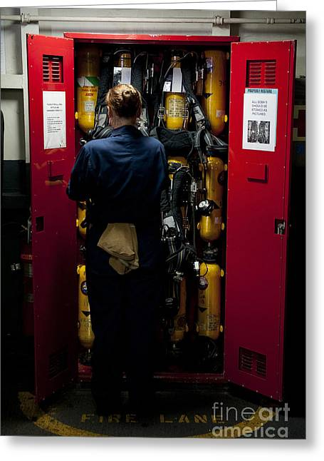 Oxygen Tank Greeting Cards - Fireman Stows A Self-contained Greeting Card by Stocktrek Images