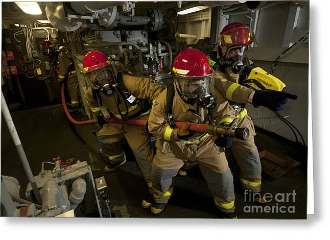 Carrier Greeting Cards - Firemen Combat A Simulated Fire Aboard Greeting Card by Stocktrek Images
