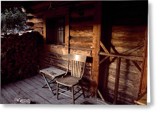Hunting Cabin Photographs Greeting Cards - Firewood And A Chair On The Porch Greeting Card by Joel Sartore