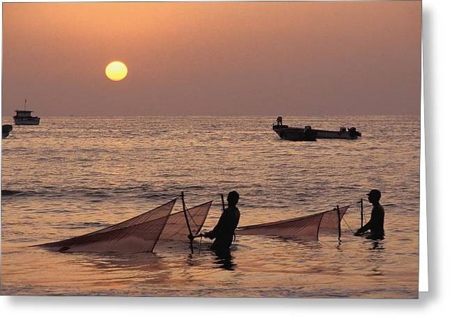 Two Fishing Men Greeting Cards - Fishermen Holding Nets In Sea At Sunset Greeting Card by Axiom Photographic
