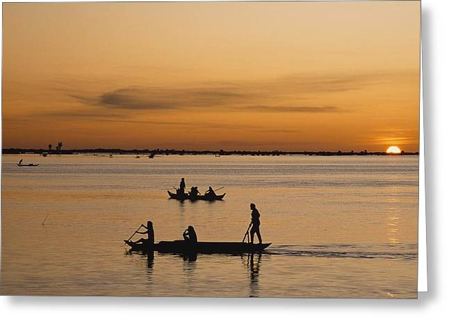 Tonle Greeting Cards - Fishermen In Silhouette On Tonle Sap Greeting Card by Axiom Photographic