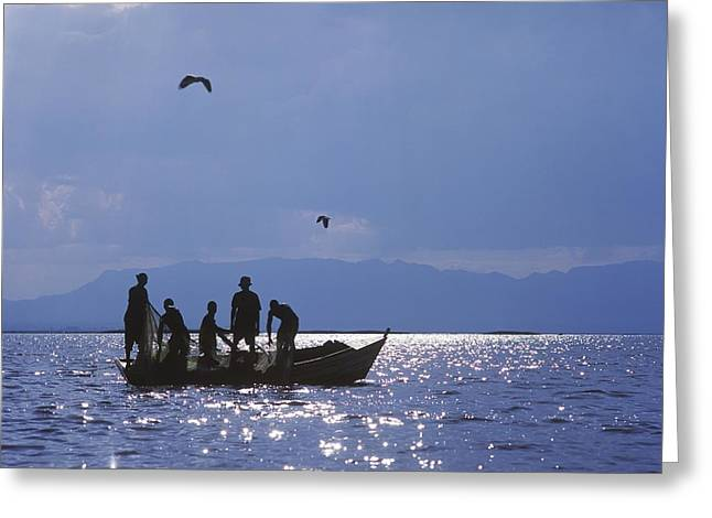 Boats In Reflecting Water Photographs Greeting Cards - Fishermen Pulling Fishing Nets On Small Greeting Card by Axiom Photographic