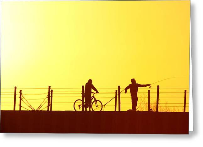 Fishing At Sunset Greeting Card by Dennis Pintoski