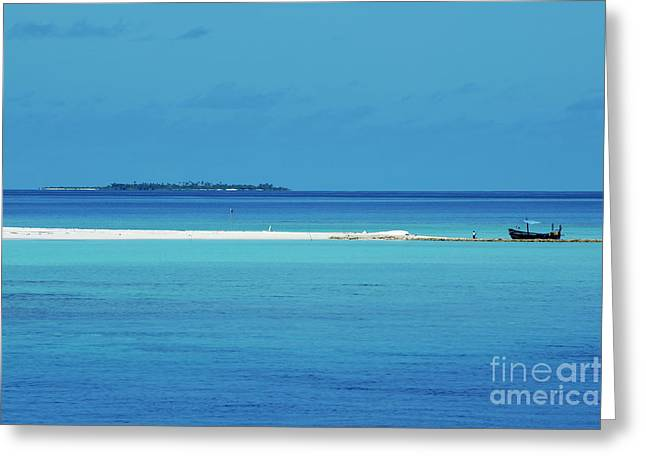 Sami Sarkis Photographs Greeting Cards - Fishing boat anchored on a white sand beach with a tropical island in the background in Maldives Greeting Card by Sami Sarkis