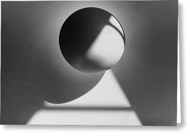 Curve Ball Greeting Cards - Floating sphere on light triangle- black and white silver gelati Greeting Card by Adam Long