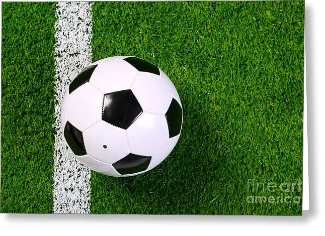Sports Equipment Greeting Cards - Football on grass from above. Greeting Card by Richard Thomas