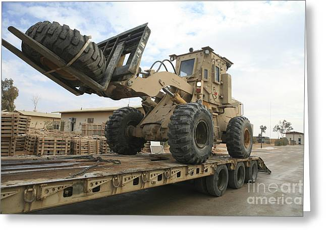 Iraq Greeting Cards - Forklift Is Unloaded Off Of A Logistics Greeting Card by Stocktrek Images