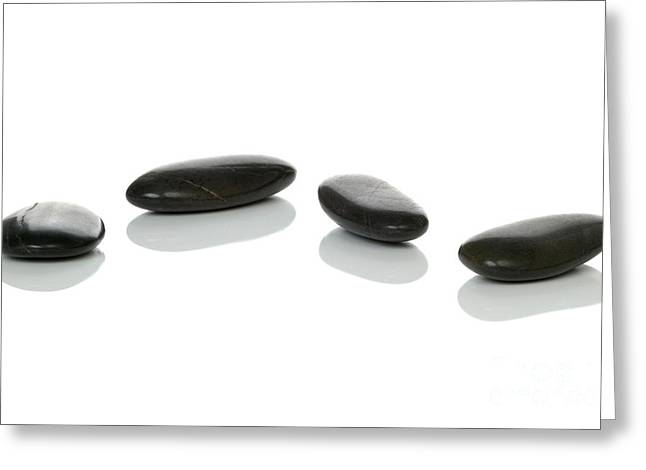 Wellbeing Greeting Cards - Four black pebbles Greeting Card by Richard Thomas