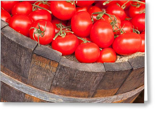 Nutrients Greeting Cards - Fresh red tomatoes in a wooden bucket Greeting Card by Tom Gowanlock