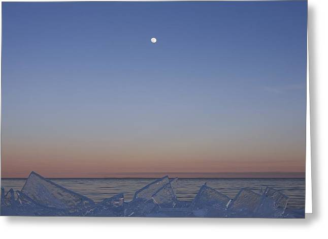 Full Moon At Dusk With Ice On Lake Greeting Card by Susan Dykstra