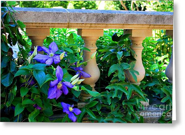 Concrete Sculpture Greeting Cards - Garden Wall With Periwinkle Flowers Greeting Card by Nancy Mueller