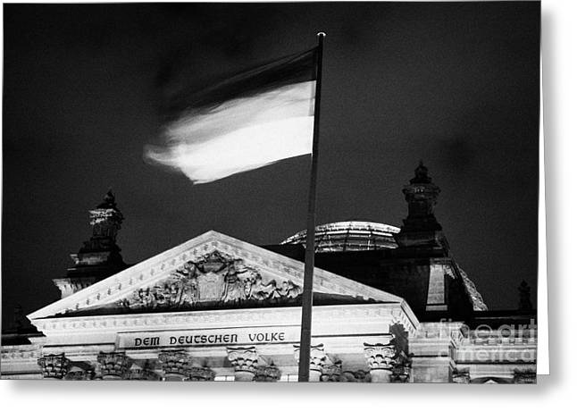 Berlin Germany Greeting Cards - german flag flying fluttering on flagpole outside reichstag building Berlin Germany Greeting Card by Joe Fox