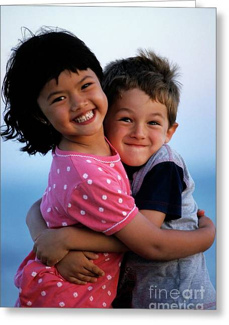 Asian Ethnicity Greeting Cards - Girl and boy embracing Greeting Card by Sami Sarkis