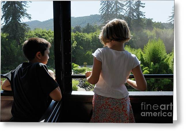 Multi-ethnic Greeting Cards - Girl and boy looking out of train window Greeting Card by Sami Sarkis