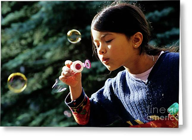 Girl Looking Down Greeting Cards - Girl blowing bubble-wand Greeting Card by Sami Sarkis